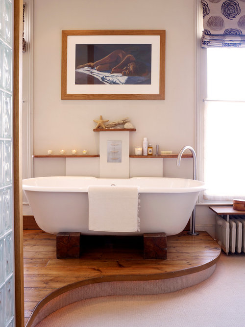 Example Of A Mid Sized Trendy Master Medium Tone Wood Floor Freestanding  Bathtub Design In