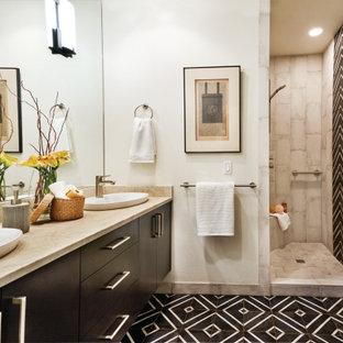 Inspiration for a transitional gray tile black floor and double-sink bathroom remodel in Portland with flat-panel cabinets, black cabinets, white walls, a vessel sink, beige countertops and a floating vanity