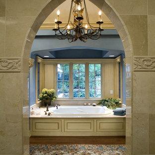 Elegant beige tile drop-in bathtub photo in Columbus