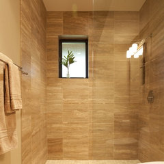 tropical bathroom by McClellan Architects