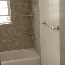 Modern Bathroom by Ryzach Construction, LLC