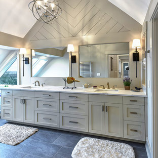 Bathroom - transitional slate floor bathroom idea in Charleston with flat-panel cabinets and engineered quartz countertops