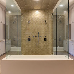 Transitional brown tile and glass tile double shower photo in Raleigh with shaker cabinets, beige cabinets and a hinged shower door