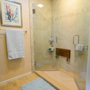 Modelo de cuarto de baño con ducha, clásico, de tamaño medio, con lavabo sobreencimera, armarios con paneles lisos, puertas de armario de madera en tonos medios, encimera de granito, ducha empotrada, sanitario de una pieza, baldosas y/o azulejos beige, baldosas y/o azulejos de porcelana, paredes beige y suelo de corcho