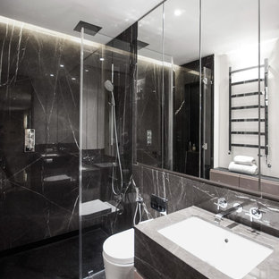 Photo of a small contemporary shower room in London with flat-panel cabinets, grey cabinets, a walk-in shower, a wall mounted toilet, grey tiles, stone slabs, black walls, slate flooring, a submerged sink and marble worktops.