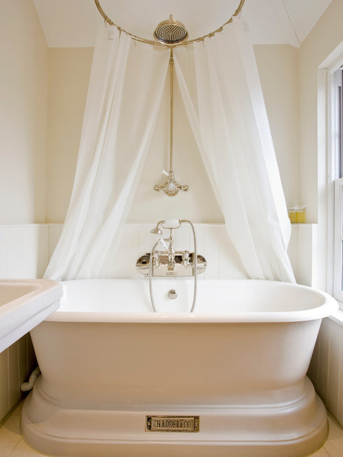 Nice Victorian Bathroom Idea In Surrey With A Freestanding Tub And Beige Walls