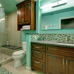 Inspiration for a mid-sized contemporary multicolored tile and glass tile porcelain floor alcove shower remodel in Austin with an undermount sink, raised-panel cabinets, medium tone wood cabinets, soapstone countertops, green walls and green countertops