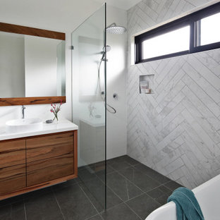 Contemporary bathroom in Perth with flat-panel cabinets, medium wood cabinets, an alcove shower, white tile, a drop-in sink, grey floor and white benchtops.