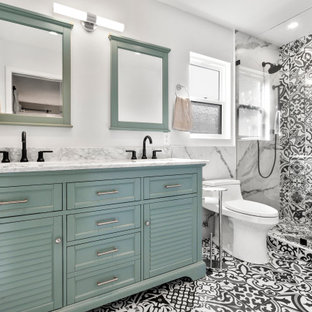 Inspiration for a large transitional 3/4 black and white tile and porcelain tile porcelain tile and multicolored floor alcove shower remodel in Los Angeles with turquoise cabinets, marble countertops, louvered cabinets, a one-piece toilet, white walls, an undermount sink, a hinged shower door and gray countertops