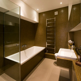 Design ideas for a contemporary bathroom in London with a built-in bath, brown tiles, mosaic tiles and a built-in sink.