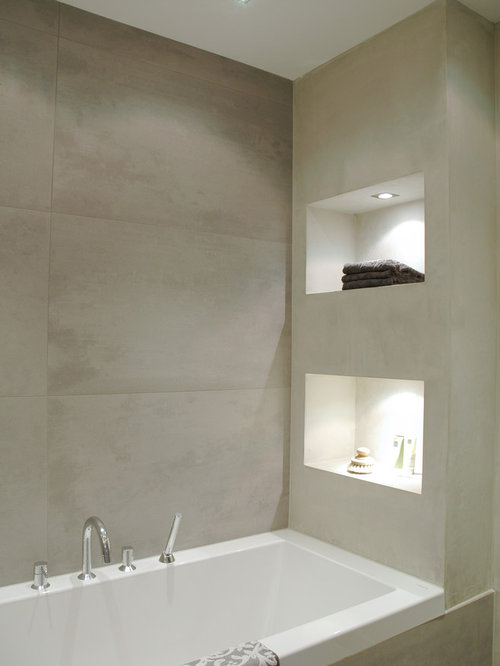 inspiration for a modern gray tile drop in bathtub remodel in amsterdam - Bathroom Remodel Modern