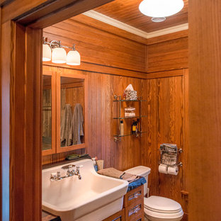 Design ideas for a small country 3/4 bathroom in New York with recessed-panel cabinets, medium wood cabinets, dark hardwood floors, a drop-in sink, wood benchtops and brown floor.