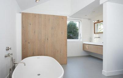 Introduce equipamiento de madera en el baño y realza su diseño