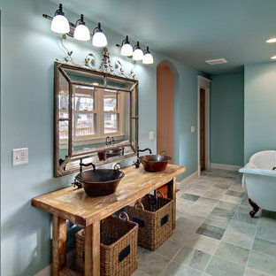 Traditional bathroom in Minneapolis with a freestanding tub and a vessel sink.