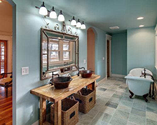 Freestanding bathtub - traditional freestanding bathtub idea in Minneapolis with a vessel sink