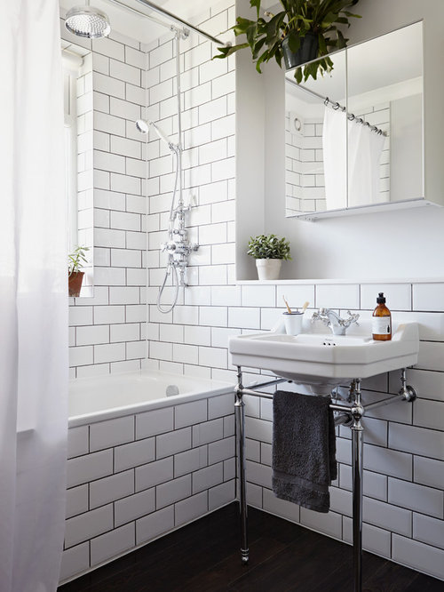 design ideas for a traditional bathroom in london with a console sink an alcove bath