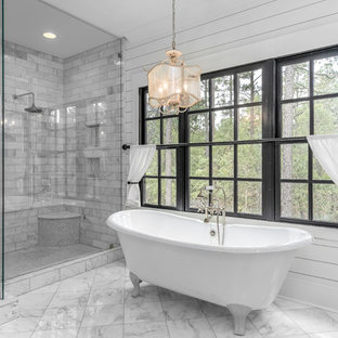 Country bathroom in Raleigh with a claw-foot bath, a corner shower, grey tiles, white walls and grey floors.
