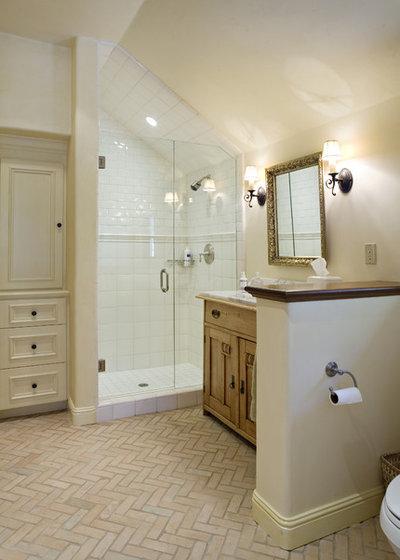 Rustic Bathroom by Claudio Ortiz Design Group, Inc.
