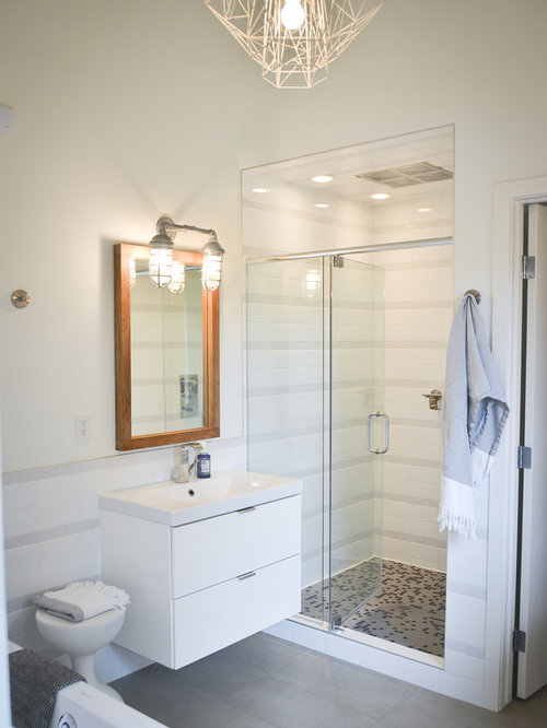 Minimalist Gray Tile Alcove Shower Photo In Calgary With Flat Panel  Cabinets And White Cabinets