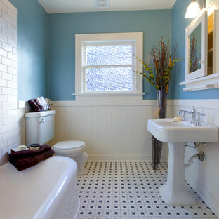 Example of a small classic 3/4 ceramic tile corner bathtub design in Chicago with glass-front cabinets, white cabinets, a two-piece toilet, blue walls and a pedestal sink