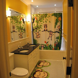 Bathroom - small traditional kids' mosaic tile and black and white tile mosaic tile floor, multicolored floor, double-sink and tray ceiling bathroom idea in New York with an undermount sink, white cabinets, quartz countertops, a two-piece toilet, recessed-panel cabinets, multicolored walls, black countertops, a niche and a freestanding vanity
