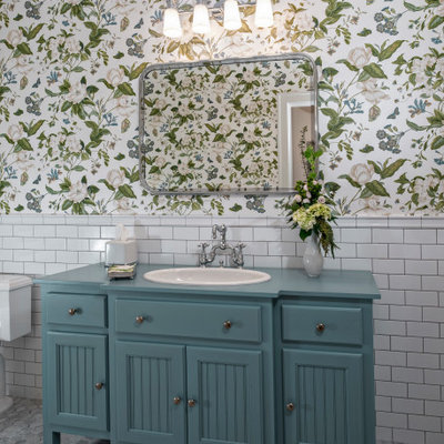 Inspiration for a tropical white tile and subway tile mosaic tile floor, gray floor and single-sink bathroom remodel in Miami with shaker cabinets, blue cabinets, multicolored walls, a drop-in sink, wood countertops, blue countertops and a freestanding vanity