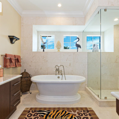 Example of an island style beige tile beige floor and single-sink bathroom design in Miami with flat-panel cabinets, dark wood cabinets, a vessel sink, white countertops and a built-in vanity
