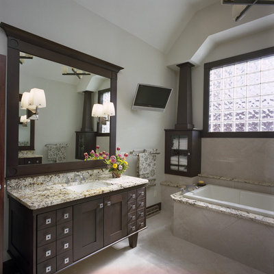 Example of a large trendy master beige tile and ceramic tile ceramic tile drop-in bathtub design in Other with granite countertops, shaker cabinets, dark wood cabinets, beige walls and an undermount sink