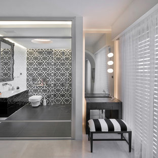 Contemporary bathroom in Other with an integrated sink, flat-panel cabinets, black cabinets and grey tiles.
