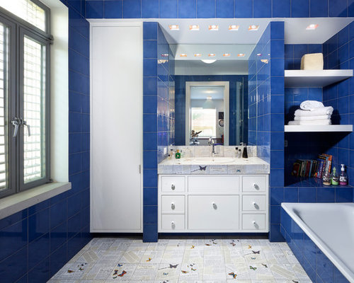 Example Of A Trendy Blue Tile Drop In Bathtub Design In Other With A Drop