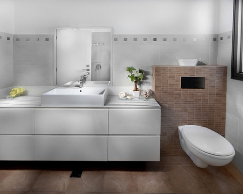 Inspiration for a modern bathroom remodel with a wallmount toilet