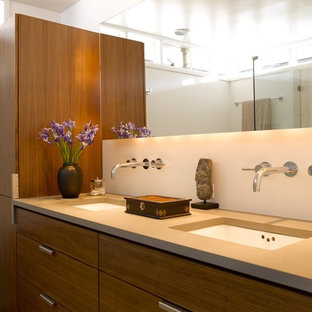 Bathroom - contemporary bathroom idea in Seattle with solid surface countertops and an undermount sink