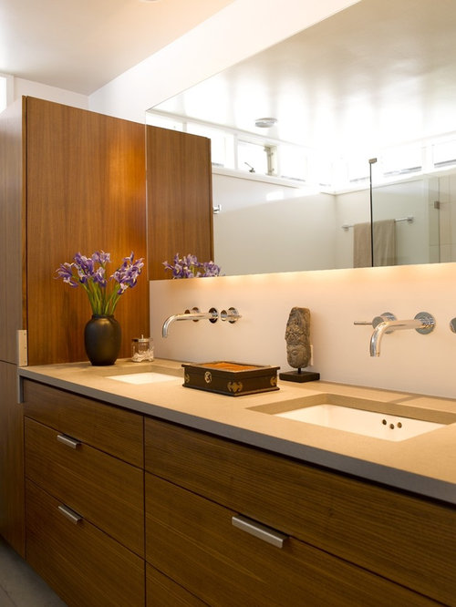 Beautiful Contemporary Bathroom Idea In Seattle With Solid Surface Countertops And An  Undermount Sink