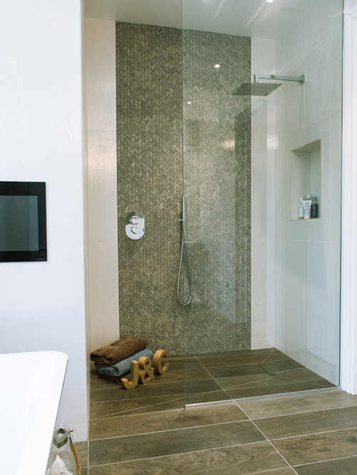 this is an example of a modern bathroom in london with a built in shower - Matchstick Tile Bedroom Decor