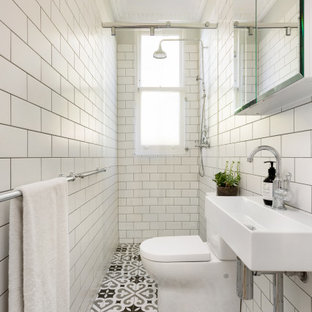 This is an example of a transitional bathroom in Sydney with white tile, subway tile, a console sink, multi-coloured floor and a single vanity.
