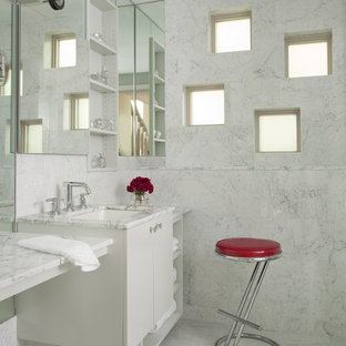 Inspiration for a contemporary shower room bathroom in Boston with marble worktops, flat-panel cabinets, white cabinets, an alcove shower, white tiles, white walls, marble flooring, marble tiles, a submerged sink, white floors and white worktops.