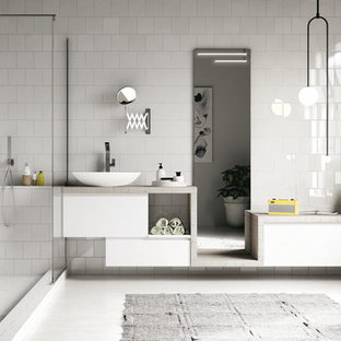 Inspiration for a contemporary bathroom in Other with flat-panel cabinets, white cabinets, a walk-in shower, white tiles, white walls, a vessel sink and an open shower.