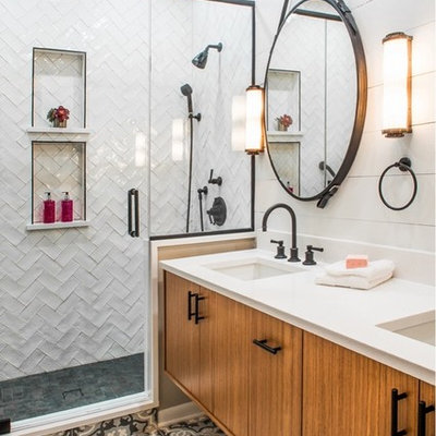 Example of a transitional 3/4 white tile cement tile floor and multicolored floor alcove shower design in Chicago with flat-panel cabinets, medium tone wood cabinets, white walls, an undermount sink and a hinged shower door