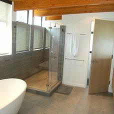 Industrial Bathroom by Landmark Builders
