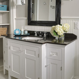 Inspiration for a small timeless white tile and subway tile mosaic tile floor bathroom remodel in St Louis with an undermount sink, furniture-like cabinets, white cabinets, granite countertops, a two-piece toilet and beige walls