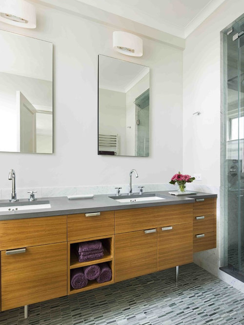 Minimalist bathroom photo in New York with flat-panel cabinets and medium tone wood cabinets