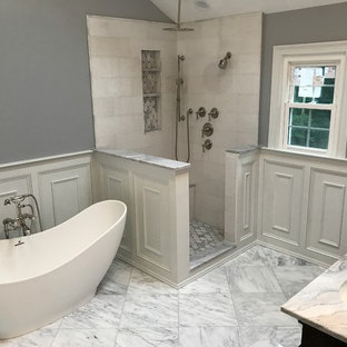 Example of a mid-sized classic master beige tile and ceramic tile marble floor and white floor bathroom design in Other with recessed-panel cabinets, dark wood cabinets, gray walls, an undermount sink and marble countertops