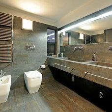 Industrial Bathroom by Marco Dellatorre