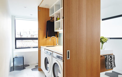 A Clever Storage Box Hides a Laundry Room Inside a Bath