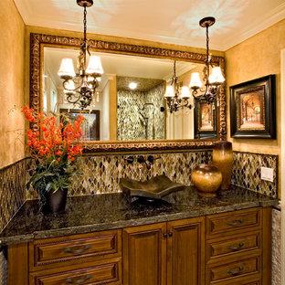 Esempio di una stanza da bagno con doccia classica di medie dimensioni con ante con bugna sagomata, ante in legno bruno, doccia ad angolo, WC a due pezzi, piastrelle multicolore, piastrelle di vetro, pareti beige, lavabo a bacinella e top in granito
