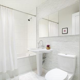Minimalist shower curtain photo in New York with a pedestal sink