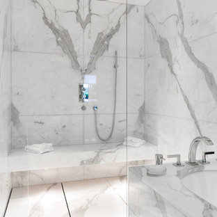 Large modern bathroom in London with marble tiles, grey walls, marble flooring, a wall-mounted sink, marble worktops, white floors and an open shower.