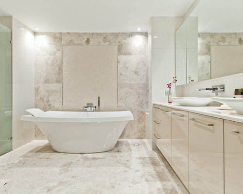 contemporary beige tile freestanding bathtub idea in perth with a vessel sink flat panel