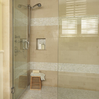 Example of a trendy mosaic tile corner shower design in Boston with a niche