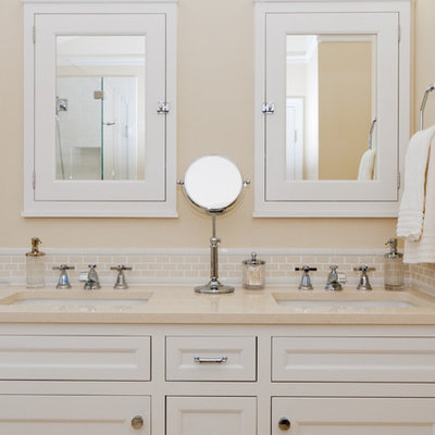 Elegant beige tile bathroom photo in DC Metro with an undermount sink, recessed-panel cabinets and white cabinets